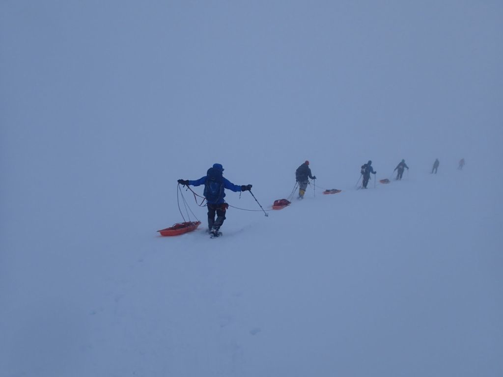 We practiced moving in rope teams with sleds in heavy snow.