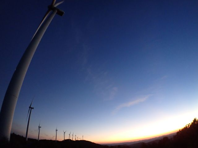 Windmills at sunset through wide angle lens