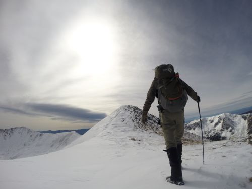 Danger striding powerfully towards the summit, and not postholing!