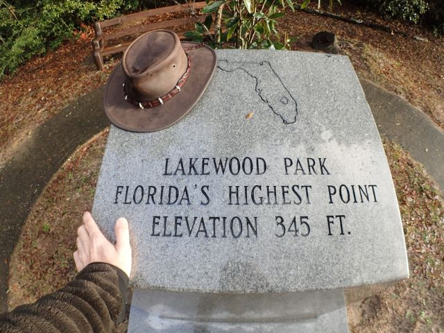 The summit marker is larger than most