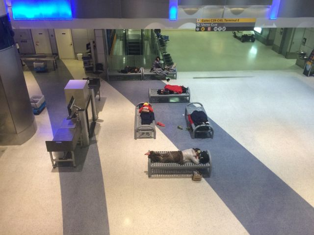 Stranded travelers were camped out everywhere in the airport.