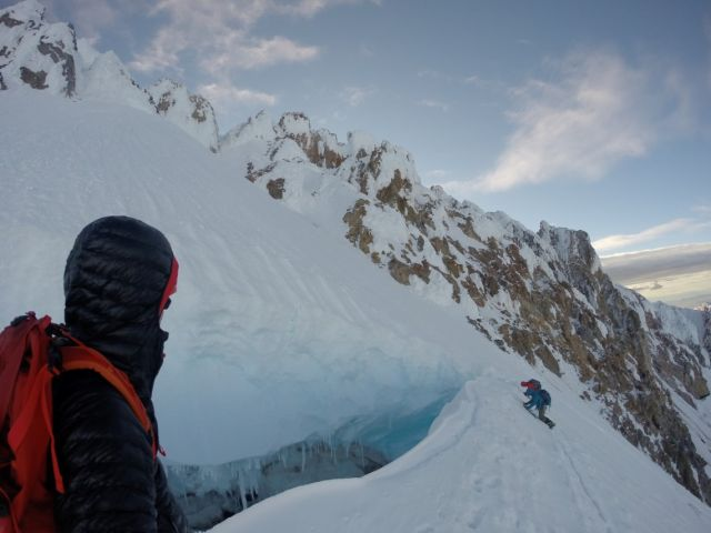 Danger looks on as two climbers work their way around a crevasse.