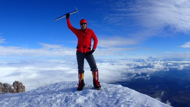 A very happy Danger stands on the summit of Mount Hood.