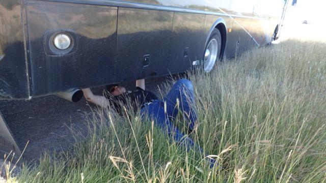 Danger repairs the rear air dump valve on BigByrd.